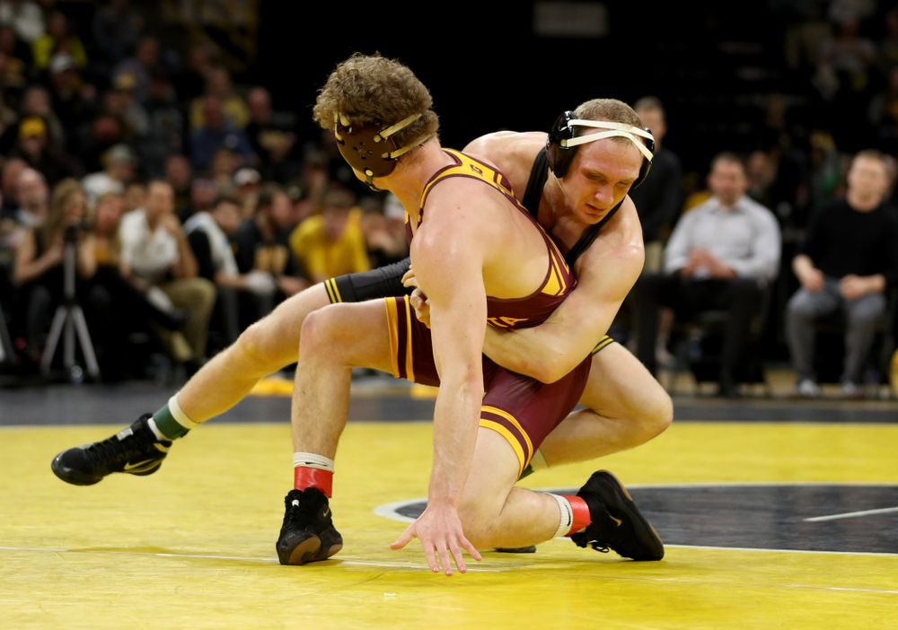 Iowa's Kaleb Young wrestles Minnesota's Ryan Thomas at 157 pounds Saturday, February 15, 2020 at Carver-Hawkeye Arena. Young won the match 5-4 in extra time. (Brian Ray/hawkeyesports.com)