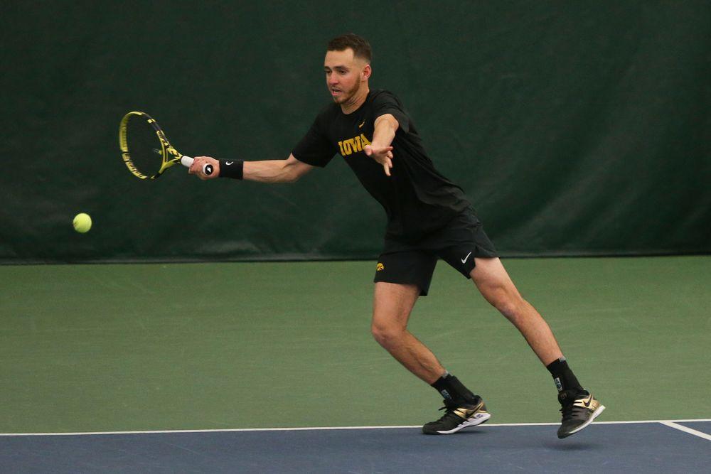 Iowa's Kareem Allaf returns a ball during the Iowa men's tennis meet vs VCU  on Saturday, February 29, 2020 at the Hawkeye Tennis and Recreation Complex. (Lily Smith/hawkeyesports.com)