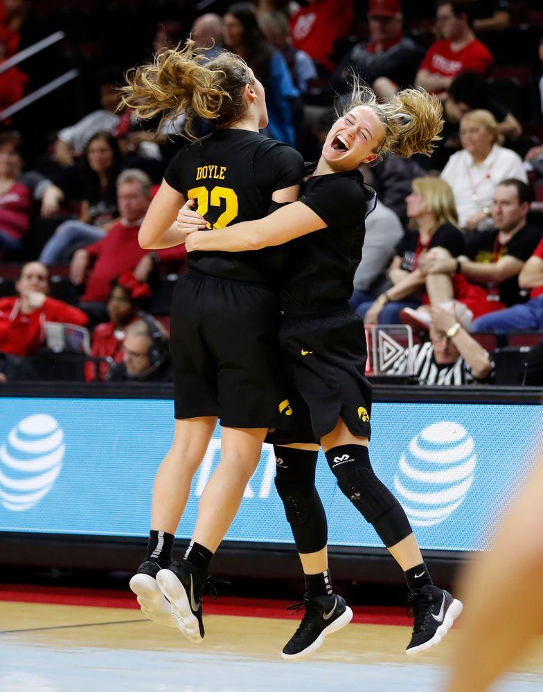 Iowa Hawkeyes guard Kathleen Doyle (22) and guard Makenzie Meyer (3)