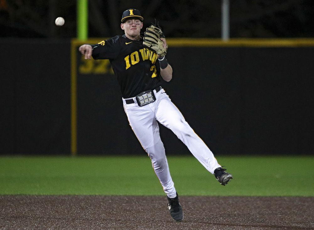 Iowa infielder Brendan Sher (2) throws to first for an out during the ninth inning of their game at Duane Banks Field in Iowa City on Tuesday, March 3, 2020. (Stephen Mally/hawkeyesports.com)