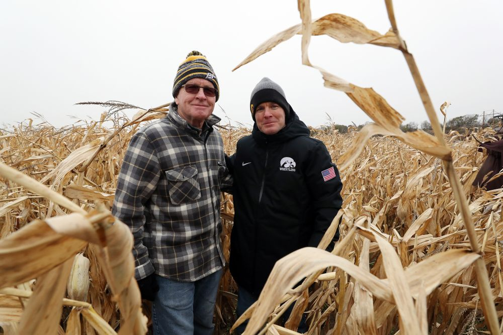 Head Coach Tom Brands poses for a photo with former Head Coach Dan Gable during the teamÕs annual media day Wednesday, October 30, 2019 at Kroul Family Farms in Mount Vernon. (Brian Ray/hawkeyesports.com)
