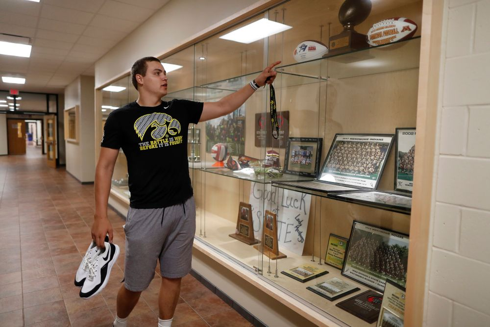 Iowa Hawkeyes quarterback Nathan Stanley (4) looks over the trophy case at his high school Wednesday, May 30, 2018 in Menomonie, Wisc. (Brian Ray/hawkeyesports.com)