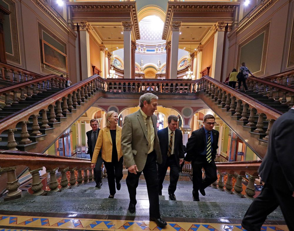 Iowa's Spencer Lee (right) walks up the stairs with Mary Harreld (from left), Bruce Harreld, University of Iowa President, and head coach Tom Brands before being honored at the Iowa State Capitol Building on Tuesday, Apr. 9, 2019. (Stephen Mally/hawkeyesports.com)