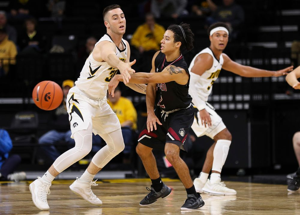 Iowa Hawkeyes guard Connor McCaffery (30) defends during a game against Guilford College at Carver-Hawkeye Arena on November 4, 2018. (Tork Mason/hawkeyesports.com)