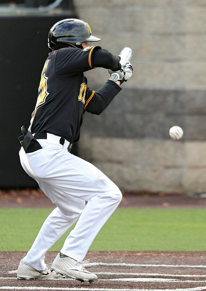 Iowa outfielder Paul Vossen (15) lays down a bunt single during the fifth inning of the first game of the Black and Gold Fall World Series at Duane Banks Field in Iowa City on Tuesday, Oct 15, 2019. (Stephen Mally/hawkeyesports.com)