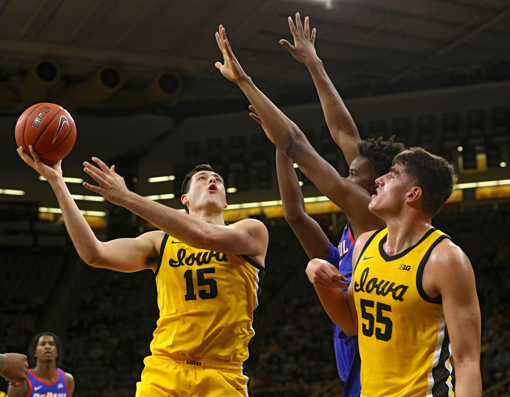 Iowa Hawkeyes forward Ryan Kriener (15) puts up a shot as center Luka Garza (55) looks on during the first half of their game at Carver-Hawkeye Arena in Iowa City on Monday, Nov 11, 2019. (Stephen Mally/hawkeyesports.com)