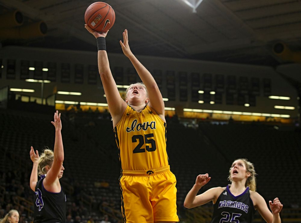 Iowa forward/center Monika Czinano (25) makes a basket during the third quarter of their game against Winona State at Carver-Hawkeye Arena in Iowa City on Sunday, Nov 3, 2019. (Stephen Mally/hawkeyesports.com)
