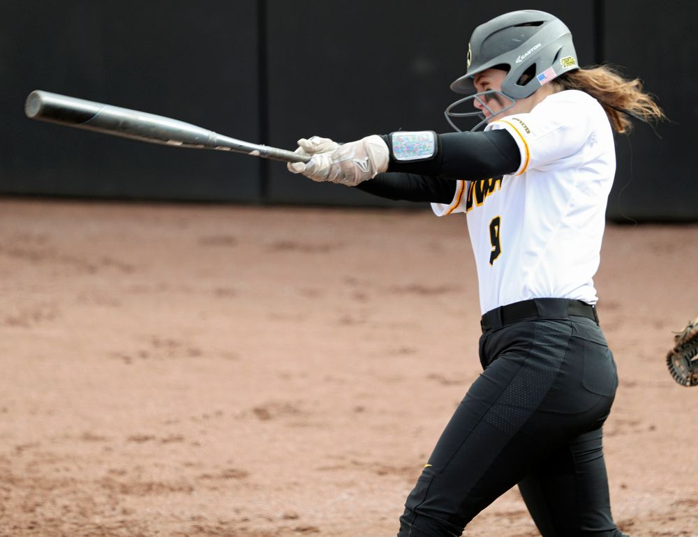 Iowa catcher Abby Lien (9) hits a home run during the second inning of their game against Illinois at Pearl Field in Iowa City on Friday, Apr. 12, 2019. (Stephen Mally/hawkeyesports.com)