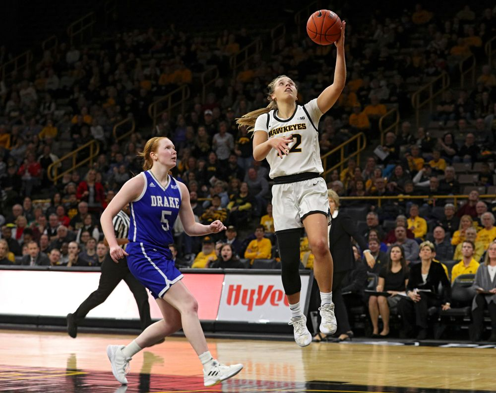 Iowa Hawkeyes guard Kathleen Doyle (22) makes a basket during the fourth quarter of their game at Carver-Hawkeye Arena in Iowa City on Saturday, December 21, 2019. (Stephen Mally/hawkeyesports.com)