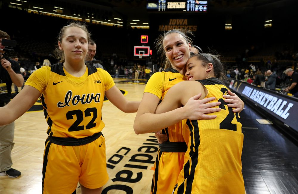 Iowa Hawkeyes guard Gabbie Marshall (24) with guard Makenzie Meyer (3) and guard Kathleen Doyle (22) during senior day activities following their win over the Minnesota Golden Gophers Thursday, February 27, 2020 at Carver-Hawkeye Arena. (Brian Ray/hawkeyesports.com)