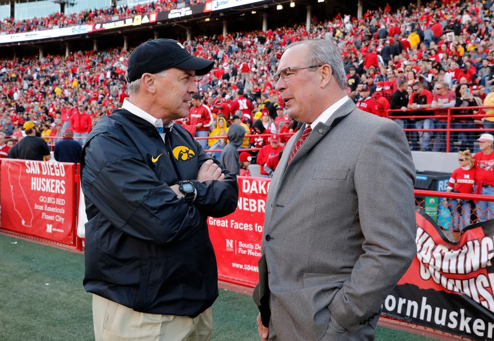 Iowa Hawkeyes Director of Athletics Gary Barta and Nebraska Athletics Director Bill Moos