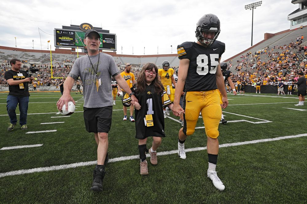 Kid Captain Lucy Roth swarms with Iowa Hawkeyes long snapper Nate Vejvoda (85) during Kids Day at Kinnick Stadium in Iowa City on Saturday, Aug 10, 2019. (Stephen Mally/hawkeyesports.com)