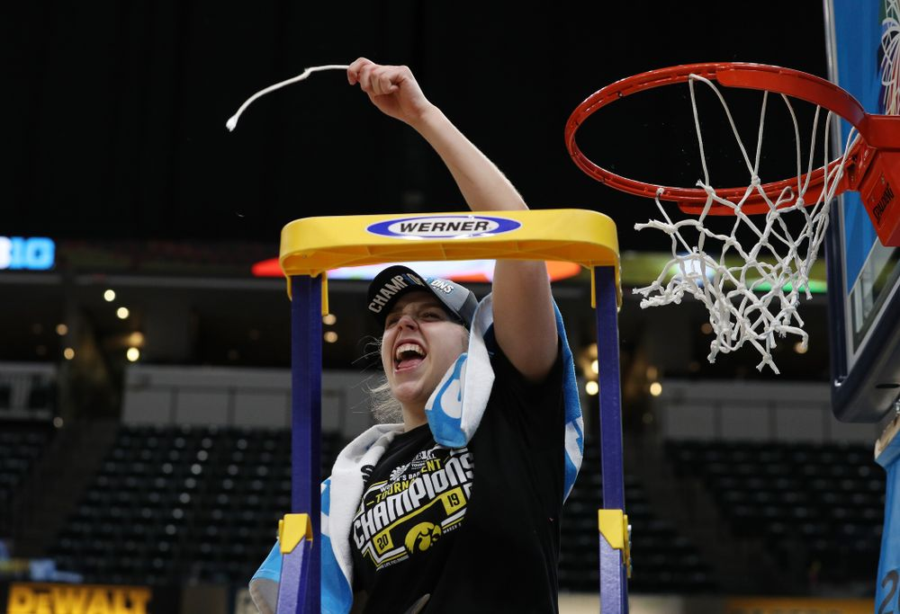 Iowa Hawkeyes guard Kathleen Doyle (22) cuts down the net as they celebrate their victory over the Maryland Terrapins in the Big Ten Championship Game Sunday, March 10, 2019 at Bankers Life Fieldhouse in Indianapolis, Ind. (Brian Ray/hawkeyesports.com)