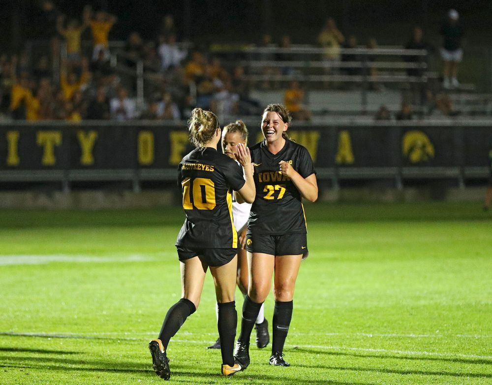 Iowa midfielder/defender Natalie Winters (10) celebrates with forward Samantha Tawharu (27) after Winters scored a goal on a penalty kick during the second half of their match against Western Michigan at the Iowa Soccer Complex in Iowa City on Thursday, Aug 22, 2019. (Stephen Mally/hawkeyesports.com)