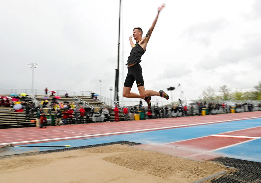 Iowa's Cooper Koenig jump in the men's long jump event on the second day of the Big Ten Outdoor Track and Field Championships at Francis X. Cretzmeyer Track in Iowa City on Saturday, May. 11, 2019. (Stephen Mally/hawkeyesports.com)