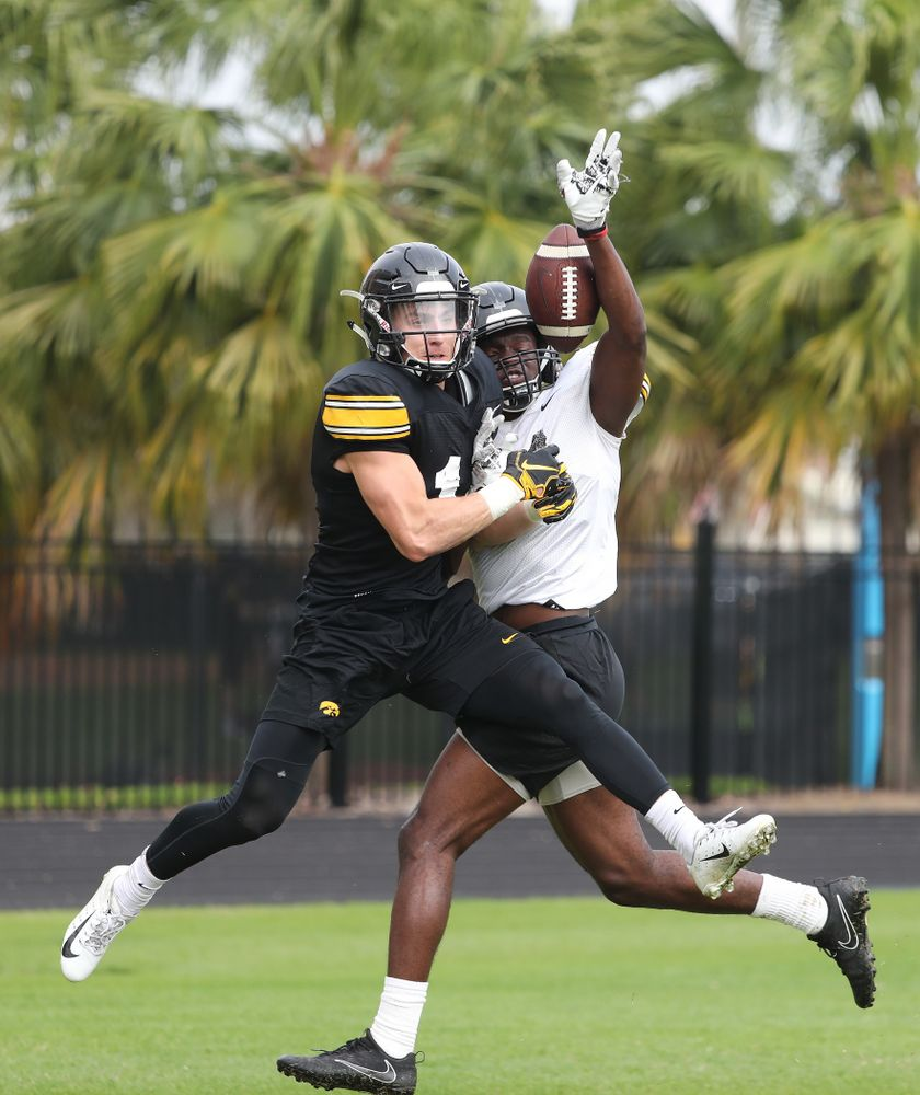 Iowa Hawkeyes defensive back Michael Ojemudia (11) and wide receiver Kyle Groeneweg (14) as the team prepares for the Outback Bowl Saturday, December 29, 2018 at Tampa University. (Brian Ray/hawkeyesports.com)