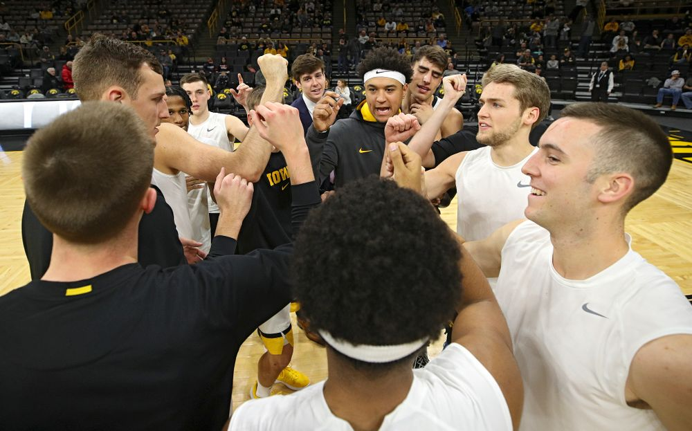 The Hawkeyes huddle as they warm up before their game at Carver-Hawkeye Arena in Iowa City on Sunday, Nov 24, 2019. (Stephen Mally/hawkeyesports.com)