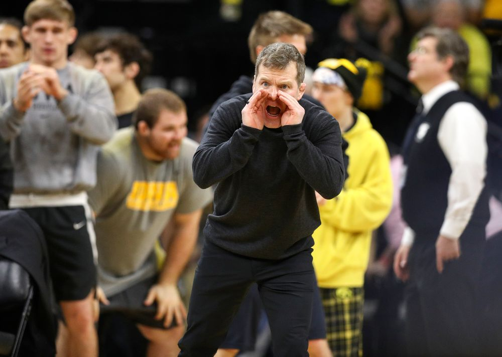 Iowa associate head coach Terry Brands shouts to Michael Kemerer in his 174-pound match during their dual at Carver-Hawkeye Arena in Iowa City on Friday, January 31, 2020. (Stephen Mally/hawkeyesports.com)