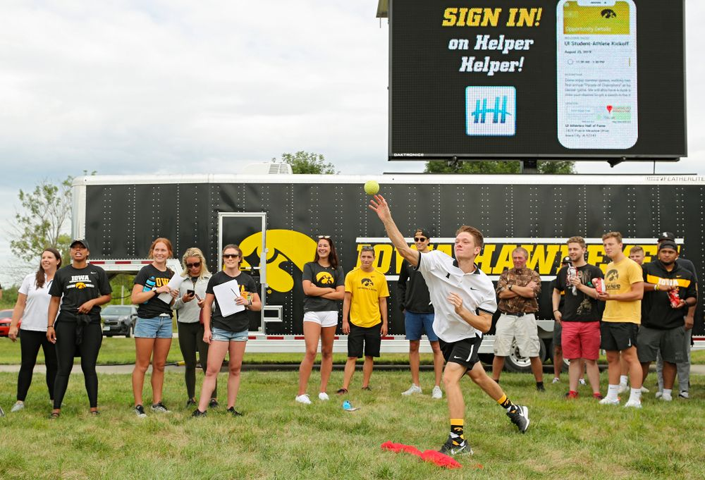 Iowa Men's Tennis' Jason Kerst tries to sink Swimming head coach Marc Long in the dunk tank during the Student-Athlete Kickoff outside the Karro Athletics Hall of Fame Building in Iowa City on Sunday, Aug 25, 2019. (Stephen Mally/hawkeyesports.com)