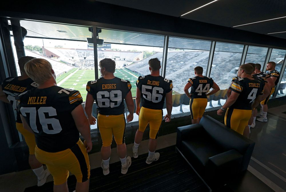 Players look at the field from the new Ted Pacha Family Club at Kinnick Stadium in Iowa City on Friday, Aug 9, 2019. (Stephen Mally/hawkeyesports.com)