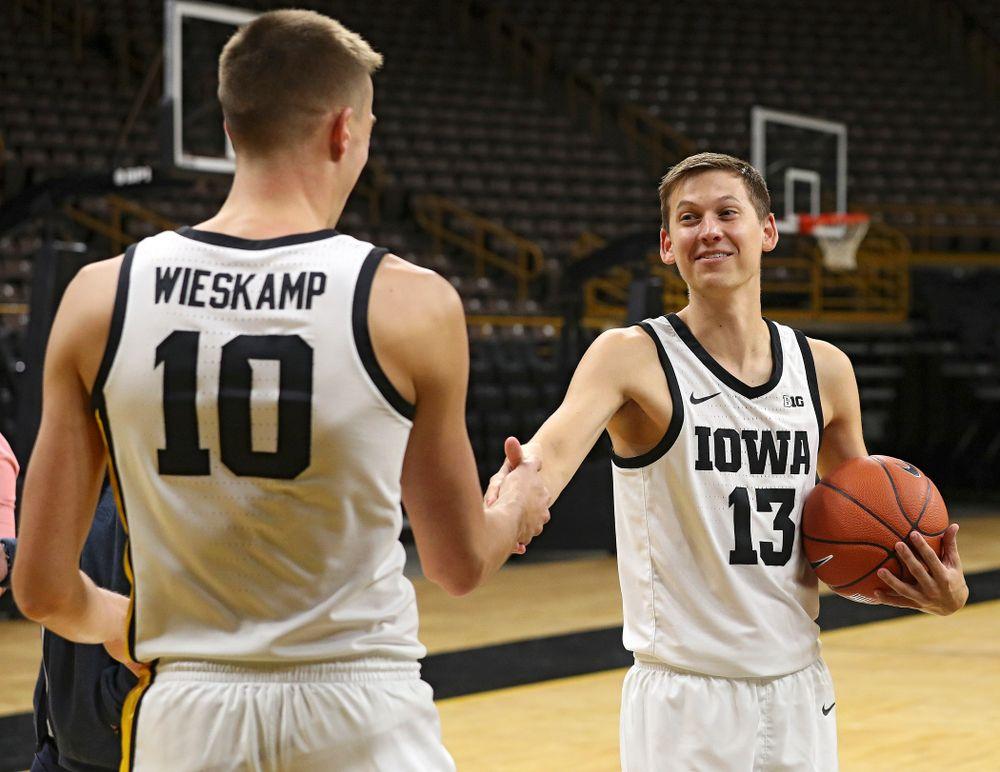 Iowa Hawkeyes guard Joe Wieskamp (10) and guard Austin Ash (13) during Iowa Men's Basketball Media Day at Carver-Hawkeye Arena in Iowa City on Wednesday, Oct 9, 2019. (Stephen Mally/hawkeyesports.com)