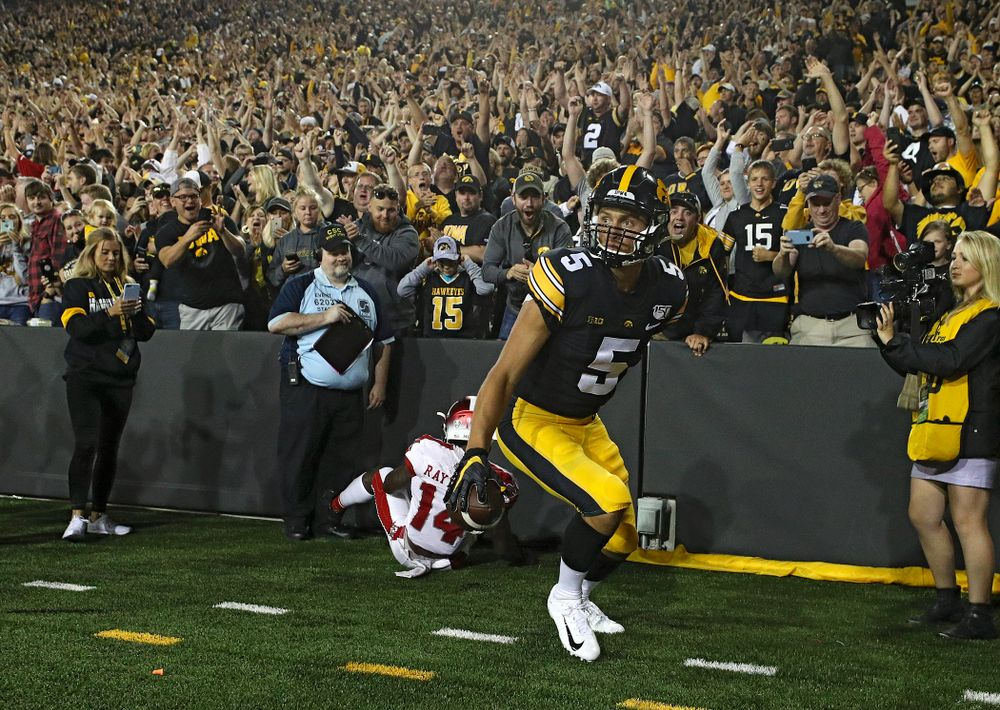 Iowa Hawkeyes wide receiver Oliver Martin (5) gets up after catching a 9-yard touchdown reception during the third quarter of their game at Kinnick Stadium in Iowa City on Saturday, Aug 31, 2019. (Stephen Mally/hawkeyesports.com)