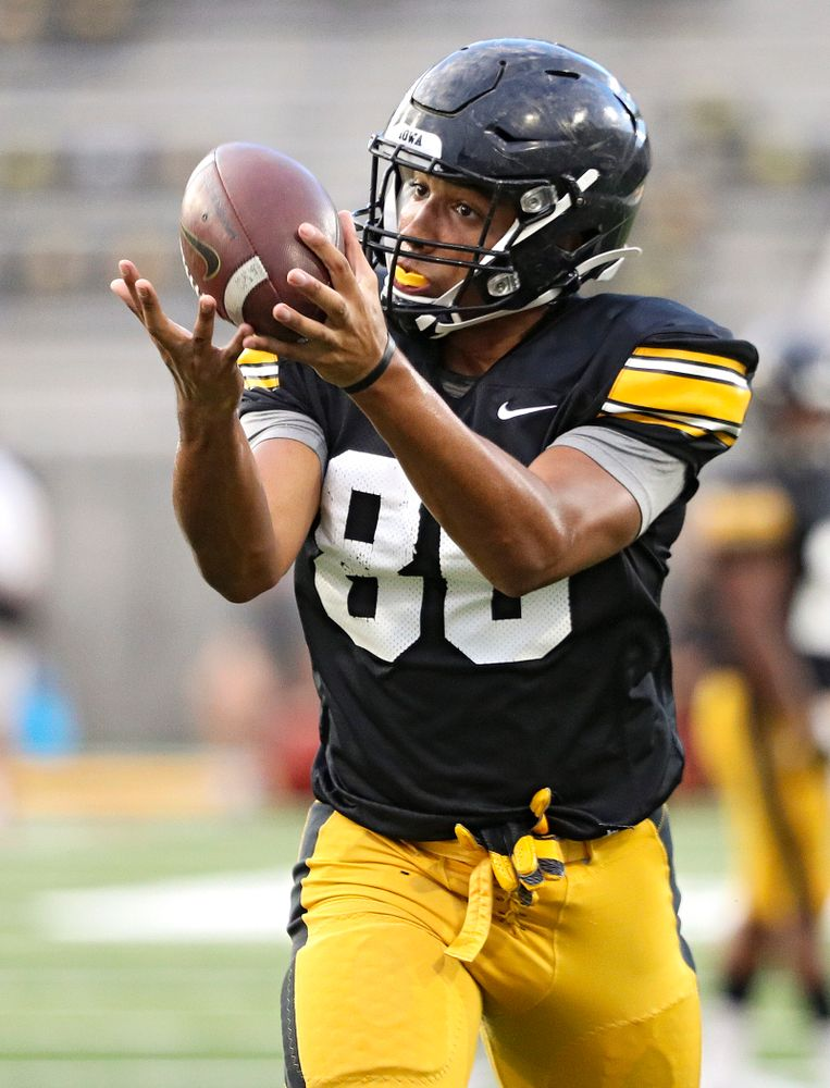 Iowa Hawkeyes tight end Josiah Miamen (80) pulls in a pass during Fall Camp Practice No. 12 at Kinnick Stadium in Iowa City on Thursday, Aug 15, 2019. (Stephen Mally/hawkeyesports.com)