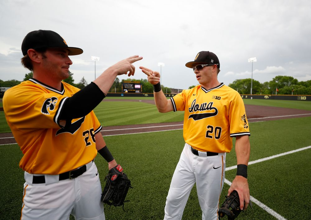 Iowa Hawkeyes catcher Austin Guzzo (20) and infielder Chris Whelan (28) against the Penn State Nittany Lions Saturday, May 19, 2018 at Duane Banks Field. (Brian Ray/hawkeyesports.com)