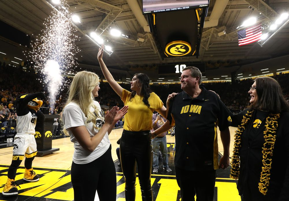 Megan Gustafson waves to the fans as her number is raised into the rafters during a jersey retirement ceremony Sunday, January 26, 2020 at Carver-Hawkeye Arena. (Brian Ray/hawkeyesports.com)