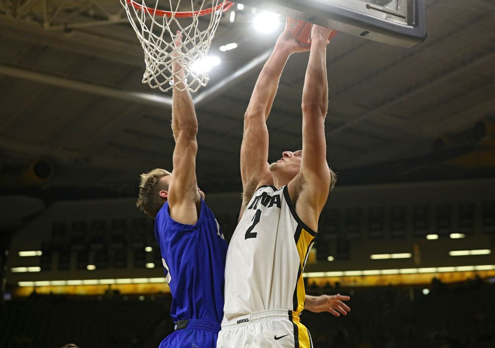 Iowa Hawkeyes forward Jack Nunge (2) dunks the ball during the first half of their exhibition game against Lindsey Wilson College at Carver-Hawkeye Arena in Iowa City on Monday, Nov 4, 2019. (Stephen Mally/hawkeyesports.com)
