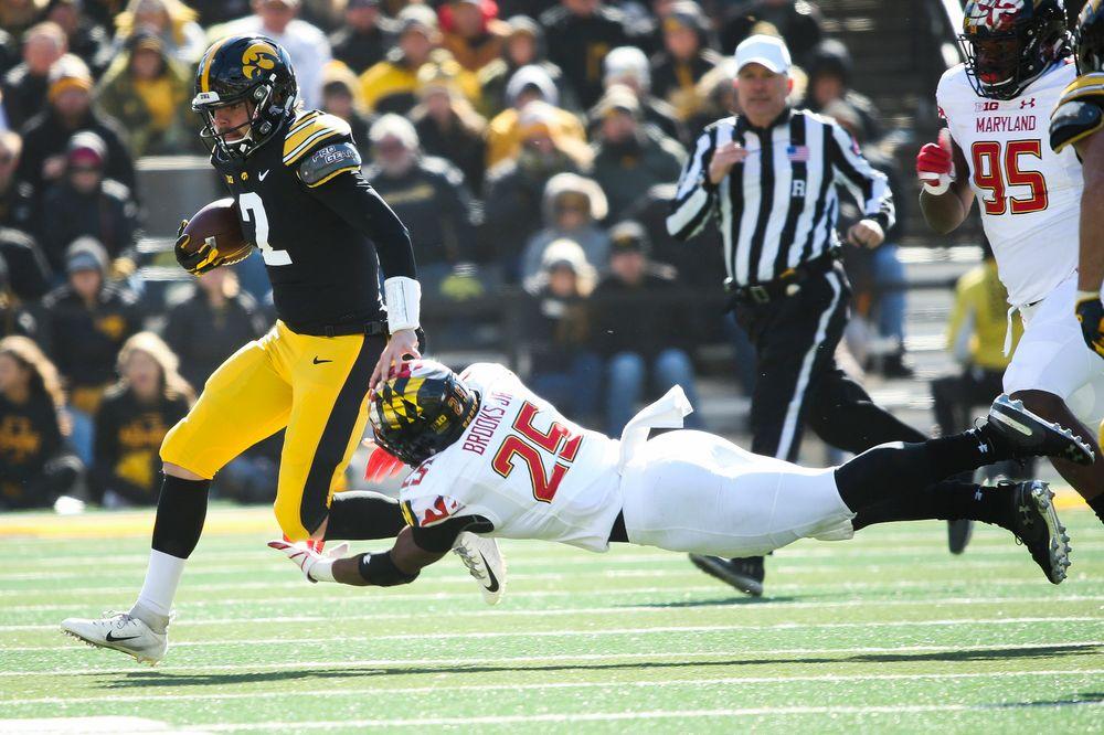 Iowa Hawkeyes quarterback Peyton Mansell (2) runs the ball during a game against Maryland at Kinnick Stadium on October 20, 2018. (Tork Mason/hawkeyesports.com)