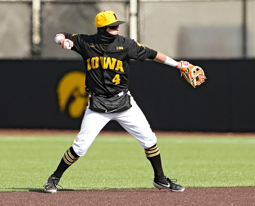 Iowa Hawkeyes second baseman Mitchell Boe (4) throws to first for an out during the seventh inning of their game against Illinois at Duane Banks Field in Iowa City on Saturday, Mar. 30, 2019. (Stephen Mally/hawkeyesports.com)