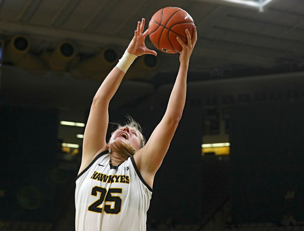 Iowa Hawkeyes forward Monika Czinano (25) grabs a ball during the second quarter of their game at Carver-Hawkeye Arena in Iowa City on Sunday, January 12, 2020. (Stephen Mally/hawkeyesports.com)