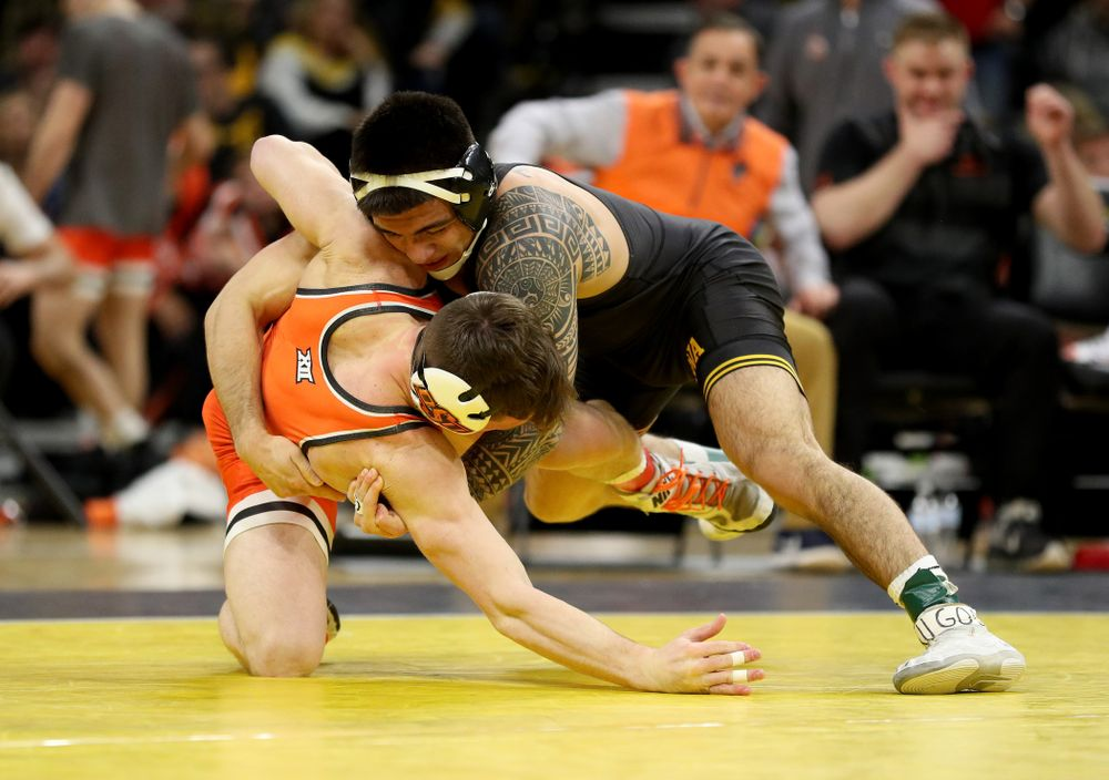 Iowa's Pat Lugo Wrestles Oklahoma State's Boo Luwallen at 149 pounds Sunday, February 23, 2020 at Carver-Hawkeye Arena. Lugo won the match by fall. (Brian Ray/hawkeyesports.com)