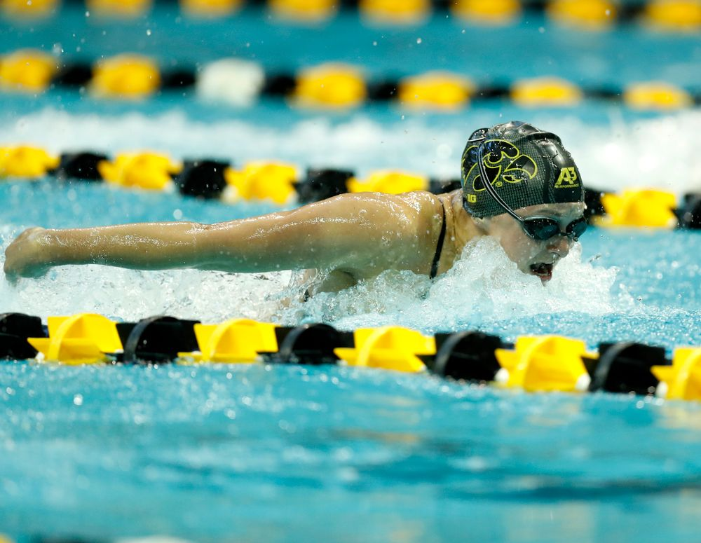 Mekenna Scheitlin swims the 100 yard butterfly
