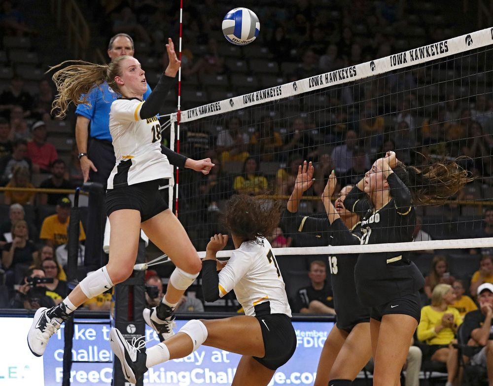 Iowa's Hannah Clayton (18) tips the ball over the net during the third set of their Big Ten/Pac-12 Challenge match against Colorado at Carver-Hawkeye Arena in Iowa City on Friday, Sep 6, 2019. (Stephen Mally/hawkeyesports.com)