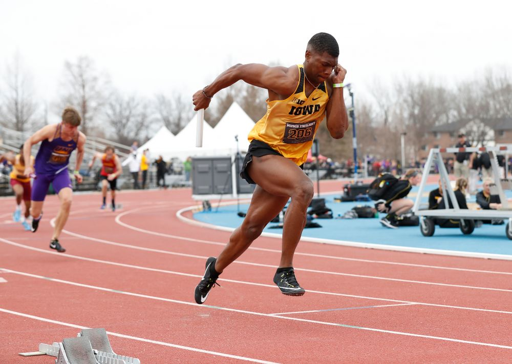 Iowa's Anthony Williams leads off the 4x100 during the 2018 MUSCO Twilight Invitational  Thursday, April 12, 2018 at the Cretzmeyer Track. (Brian Ray/hawkeyesports.com)