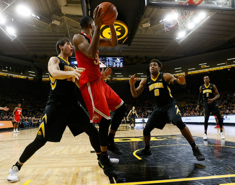 Iowa Hawkeyes forward Ryan Kriener (15), Iowa Hawkeyes forward Ahmad Wagner (0)