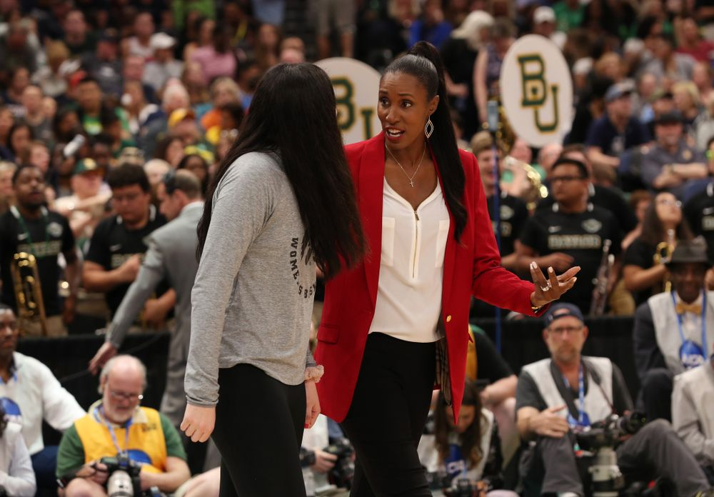 Iowa Hawkeyes forward Megan Gustafson (10) is introduced with Lisa Leslie and the other members of the Naismith Starting 5 during a timeout in the second half of the National Semi-Final between Baylor and Oregon Friday, April 5, 2019 at Amalie Arena in Tampa, FL. (Brian Ray/hawkeyesports.com)