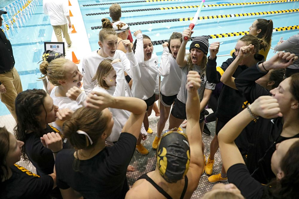 The Hawkeyes huddle during the 2020 Women's Big Ten Swimming and Diving Championships at the Campus Recreation and Wellness Center in Iowa City on Friday, February 21, 2020. (Stephen Mally/hawkeyesports.com)