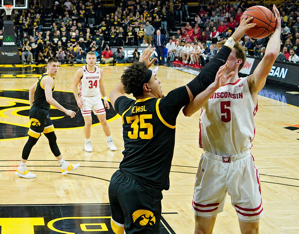 Iowa Hawkeyes forward Cordell Pemsl (35) blocks a shot by Wisconsin Badgers forward Tyler Wahl (5) during the first half of their game at Carver-Hawkeye Arena in Iowa City on Monday, January 27, 2020. (Stephen Mally/hawkeyesports.com)