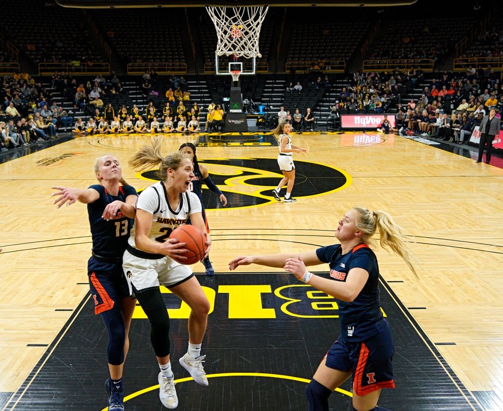 Iowa Hawkeyes guard Kathleen Doyle (22) pulls in a rebound during the third quarter of their game at Carver-Hawkeye Arena in Iowa City on Tuesday, December 31, 2019. (Stephen Mally/hawkeyesports.com)