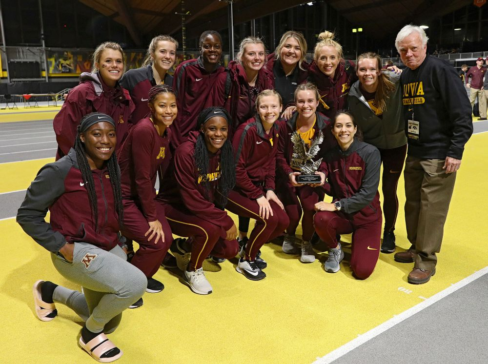 Larry Wieczorek hands out the women's team award to Minnesota during the Larry Wieczorek Invitational at the Recreation Building in Iowa City on Saturday, January 18, 2020. (Stephen Mally/hawkeyesports.com)