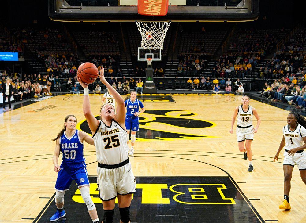 Iowa Hawkeyes forward Monika Czinano (25) scores a basket during the second quarter of their game at Carver-Hawkeye Arena in Iowa City on Saturday, December 21, 2019. (Stephen Mally/hawkeyesports.com)