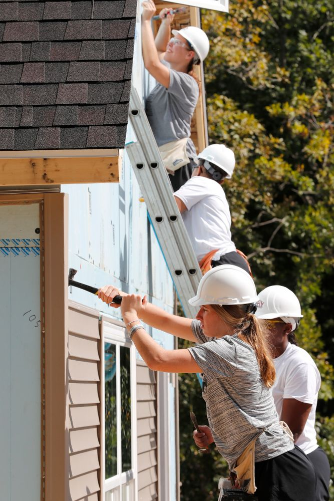 Iowa Hawkeyes forward Logan Cook (23) works on the Habitat for Humanity Women's Build Wednesday, September 26, 2018 in Iowa City. (Brian Ray/hawkeyesports.com)