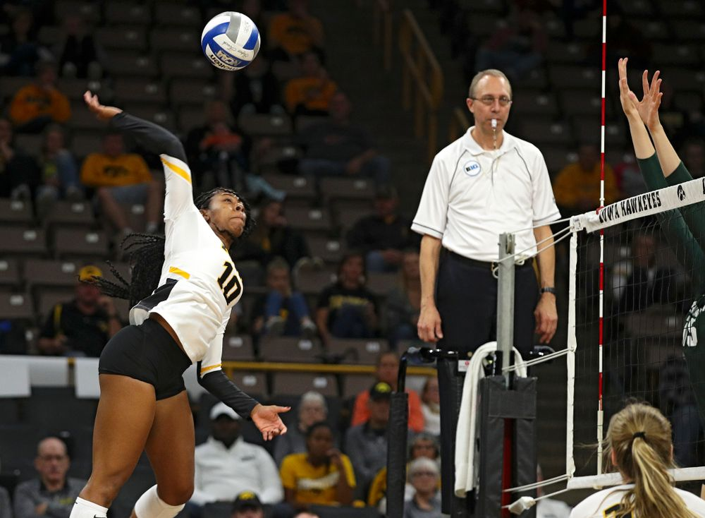 Iowa's Griere Hughes (10) lines up a kill during the third set of their volleyball match at Carver-Hawkeye Arena in Iowa City on Sunday, Oct 13, 2019. (Stephen Mally/hawkeyesports.com)