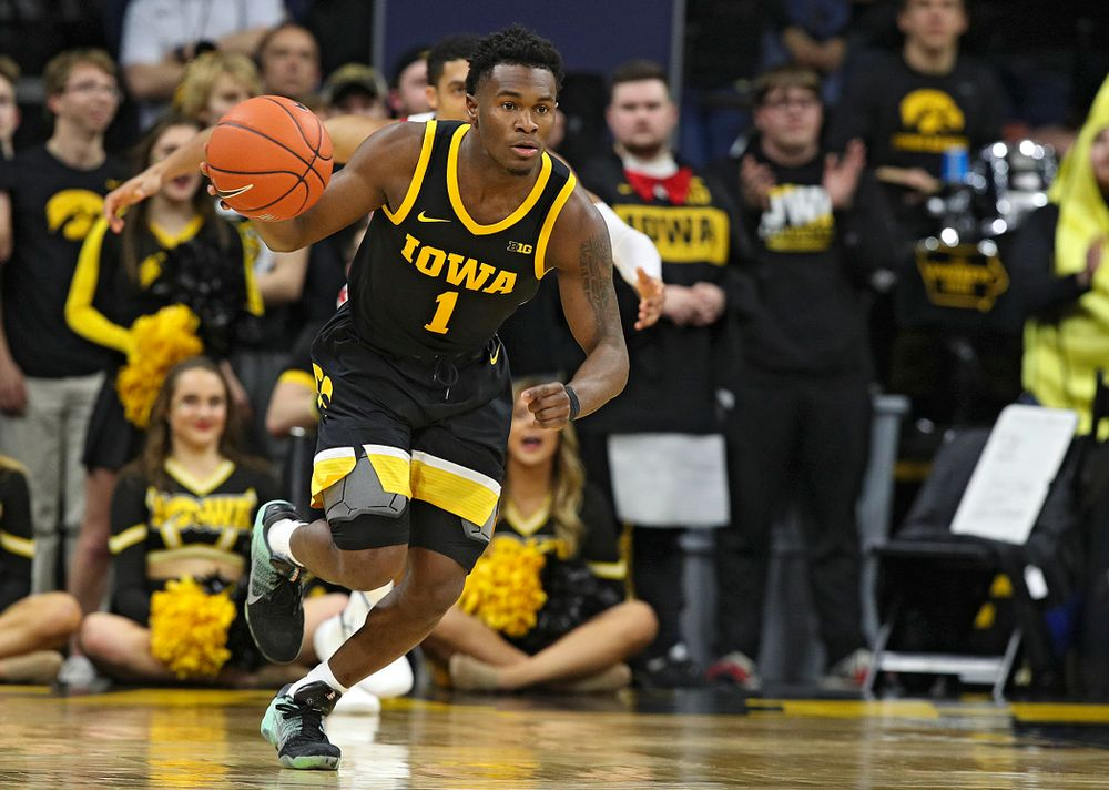Iowa Hawkeyes guard Joe Toussaint (1) brings the ball down the court during the second half of their game at Carver-Hawkeye Arena in Iowa City on Monday, January 27, 2020. (Stephen Mally/hawkeyesports.com)