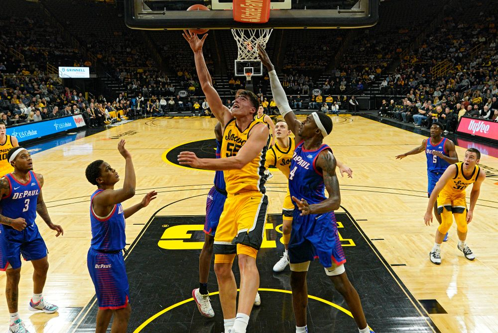 Iowa Hawkeyes center Luka Garza (55) makes a basket inside during the first half of their game at Carver-Hawkeye Arena in Iowa City on Monday, Nov 11, 2019. (Stephen Mally/hawkeyesports.com)