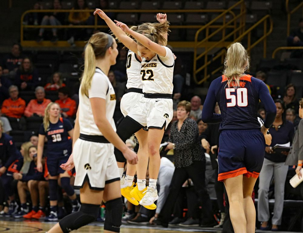 Iowa Hawkeyes guard Kate Martin (20) and guard Kathleen Doyle (22) celebrate during the fourth quarter of their game at Carver-Hawkeye Arena in Iowa City on Tuesday, December 31, 2019. (Stephen Mally/hawkeyesports.com)