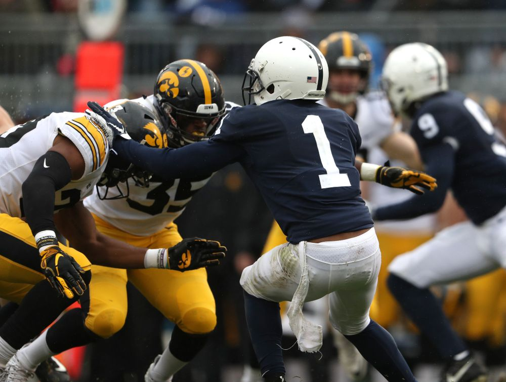 Iowa Hawkeyes wide receiver Dominique Dafney (23) hits Penn State Nittany Lions wide receiver KJ Hamler (1) on a kick off Saturday, October 27, 2018 at Beaver Stadium in University Park, Pa. (Brian Ray/hawkeyesports.com)